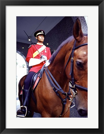 Framed Malaysia, Kuala Lumpur: a mounted guard stands in front of the Royal Palace Print