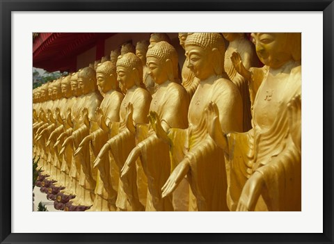 Framed Taiwan, Foukuangshan Temple, Standing gold-colored Buddha statues at a Buddhist shrine Print