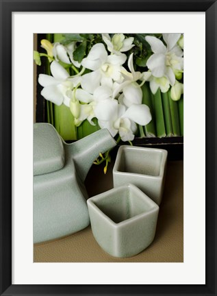 Framed Traditional Thai tea pot and cups with orchid arrangement, Bangkok, Thailand Print