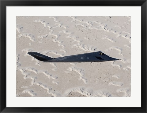 Framed F-117 Nighthawk Flies over White Sands National Monument, New Mexico Print