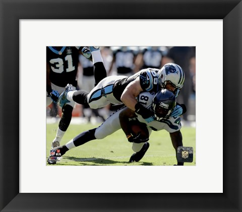 Framed Luke Kuechly with the ball 2014 Print