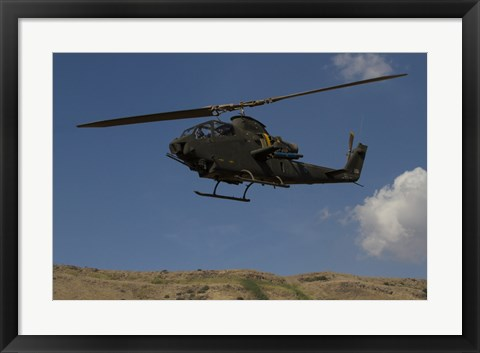 Framed AH-1F Tzefa of the Israeli Air Force flying over the Golan Heights, Israel Print