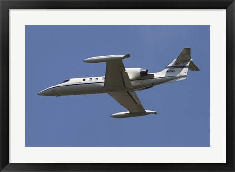 Framed United States Air Forces Europe C-21A Learjet in Flight over Germany Print