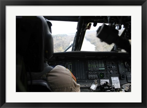 Framed UH-60 Blackhawk flies the River to an Unknown Village to Drop off a Care Package Print