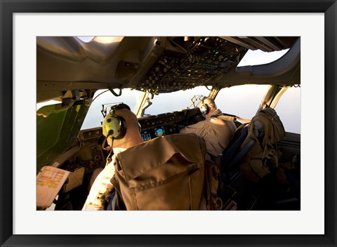 Framed US Army Pilots in-Flight in the Cockpit of a C-17 Globemaster III during a Mission to Qatar Print
