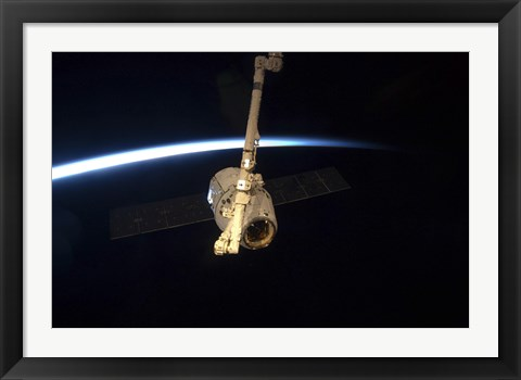 Framed SpaceX Dragon Cargo Craft with Earth's Horizon in the Background Print