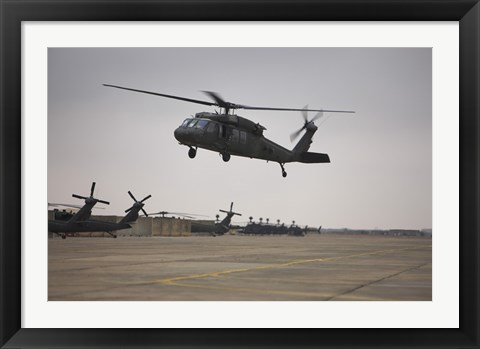 Framed UH-60 Black Hawk Taking off for a Mission Over Northern Iraq Print