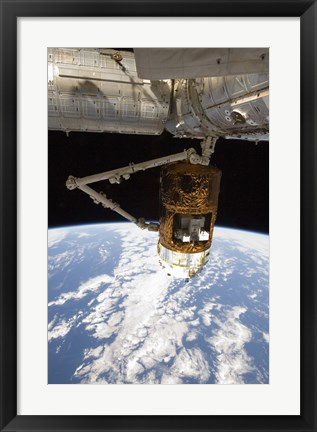 Framed Japanese H-II Transfer Vehicle in the Grasp of Canadarm2 Print