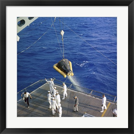 Framed Gemini-3 spacecraft is hoisted aboard the USS Intrepid during Recovery Print