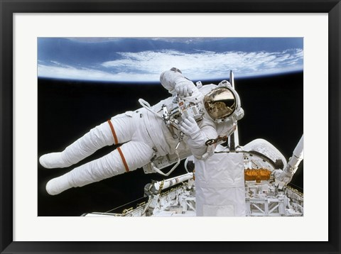 Framed Astronaut Participates in Extravehicular Activity Print