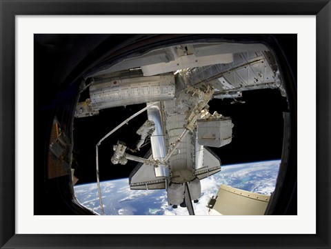 Framed Astronaut Participates in a Spacewalk while Anchored to a Foot Restraint Print