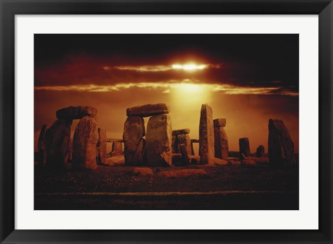 Framed Composite of a Sunset over Stonehenge, Wiltshire, England Print
