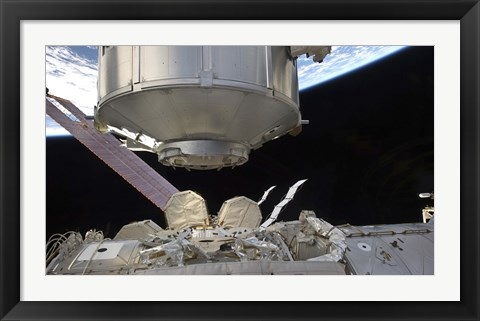 Framed Multipurpose Module in the grasp of Canadarm2 Print