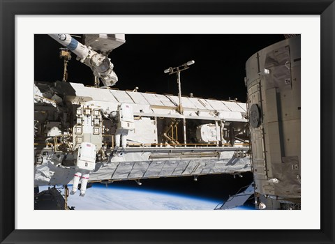 Framed Astronauts continue Maintenance Activities outside the International Space Station Print