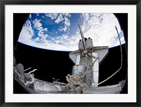 Framed Space Shuttle Discovery Backdropped by Earth's horizon Print