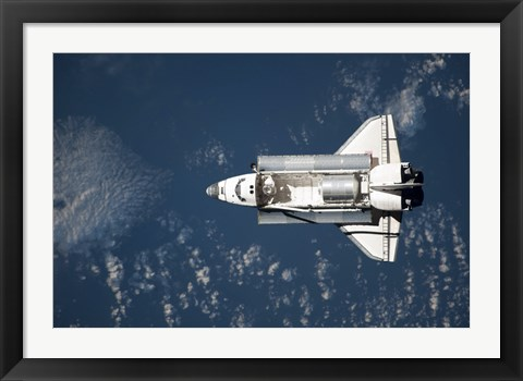 Framed Aerial view of Space Shuttle Discovery over Earth Print