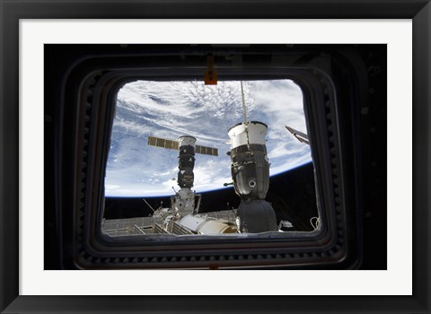Framed Two Russian Spacecraft Docked with the International Space Station, as seen from Space Shuttle Discovery's Flight Deck Window Print