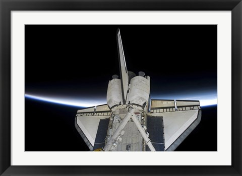 Framed Space Shuttle Discovery Intersecting the Thin line of Earth's Atmosphere, while Docked with the International Space Station Print