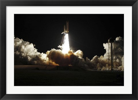 Framed Space shuttle Discovery lifts off from Launch Pad 39A at Kennedy Space Center in Florida, on the STS-131 mission Print