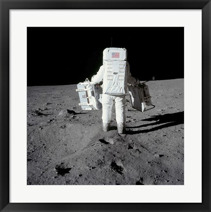 Framed Astronaut Carrying Equipment to the Deployment Site on the Moon Print
