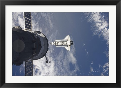 Framed Space Shuttle Atlantis and a Russian Spacecraft backdropped by a Blue and White Earth Print