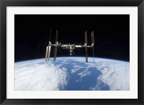 Framed International Space Station backdropped by Earth's Horizon Print
