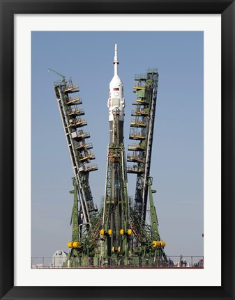 Framed Launch Scaffolding is Raised into place around the Soyuz Rocket Print