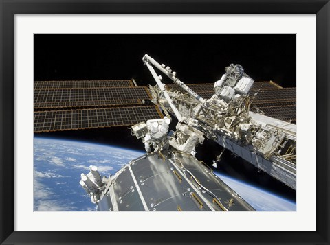 Framed Astronauts Perform a Series of Tasks on the Exterior of the International Space Station Print