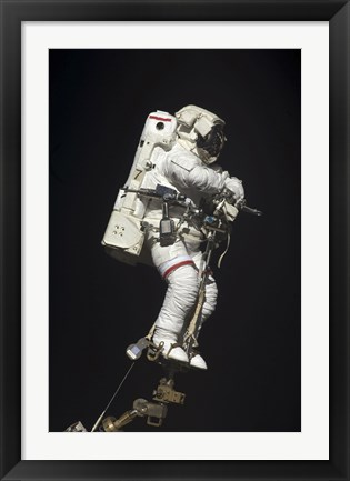 Framed Astronaut Attached to a Foot Restraint during Extravehicular Activity Print