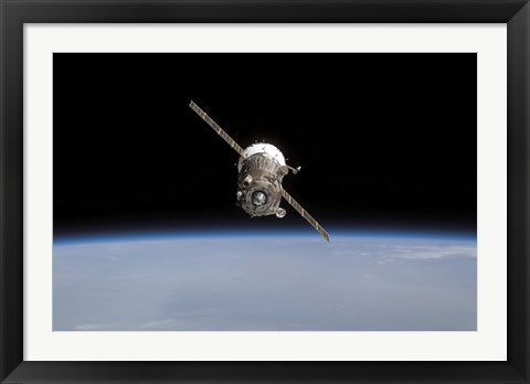Framed Soyuz TMA-11 Spacecraft Above Earth's Horizon Print