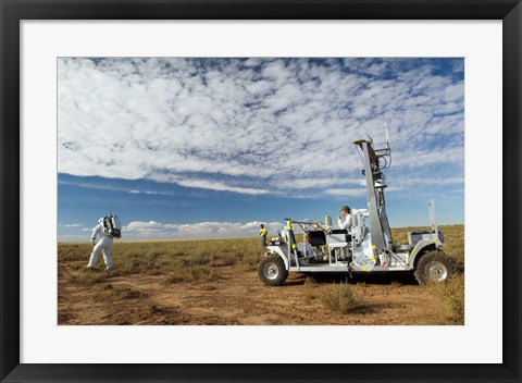 Framed SCOUT Rover Testbed Follows an Astronaut Print