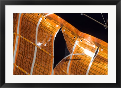Framed Close-up of a Tear in Solar Array Material on the International Space Station Print
