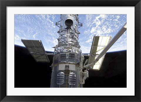 Framed Astronauts Participate in a Spacewalk on the Hubble Space Telescope Print