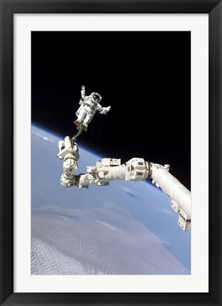 Framed Astronaut Anchored to a Foot Restraint on the International Space Stations Canadarm2 Print