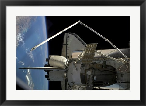 Framed Soyuz Vehicle and the Space Shuttle Discovery Docked to the International Space Station Print