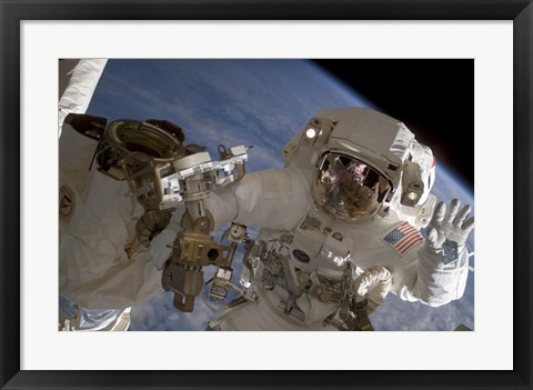 Framed Astronaut Waves to the Camera While Participating in a Session of Extravehicular Activity Print