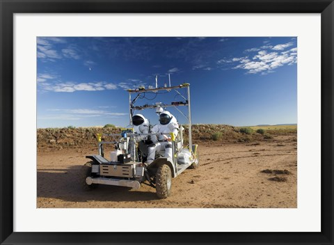 Framed Two Astronauts Take a Ride on SCOUT During Desert RATS activity in Arizona Print