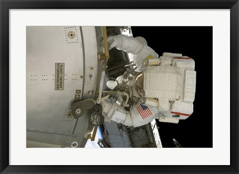 Framed Astronaut Works on the New Columbus Laboratory's Exterior During a Spacewalk Print