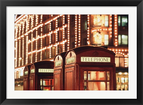 Framed Lit Telephone booth at Harrods, Knightsbridge, London, England Print