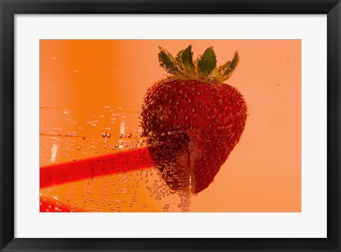 Framed Strawberry On Red Swirl Glass Print