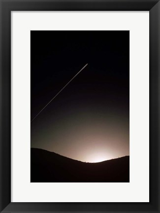 Framed Contrail At Dusk Print