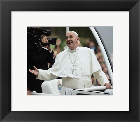 Framed Pope Francis smiles at the crowd as he rides through New York's Central Park- Friday, September 25, 2015 Print