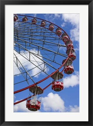 Framed Bright Colored Carnival Ride against Blue Sky Print