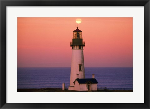 Framed Tall Lighttower Against the Ocean Print