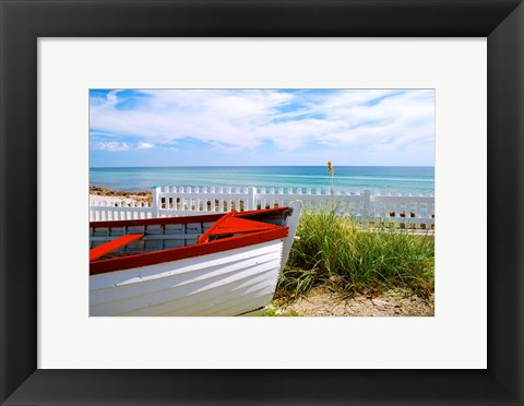 Framed Boat By The Beach Print