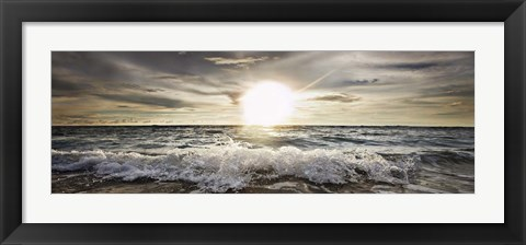 Framed Sun Shining over Rocky Waves Print