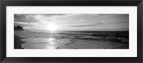 Framed Sunset over the sea Print