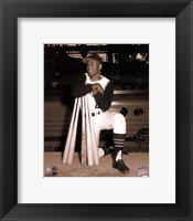 Framed Roberto Clemente leaning on bats