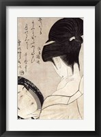 Framed Young woman applying make-up