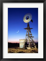Framed Industrial windmill at night, California, USA